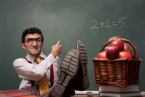 http://www.gettyimages.com/detail/photo/nerd-teacher-in-classroom-with-basket-of-apples-royalty-free-image/165830984